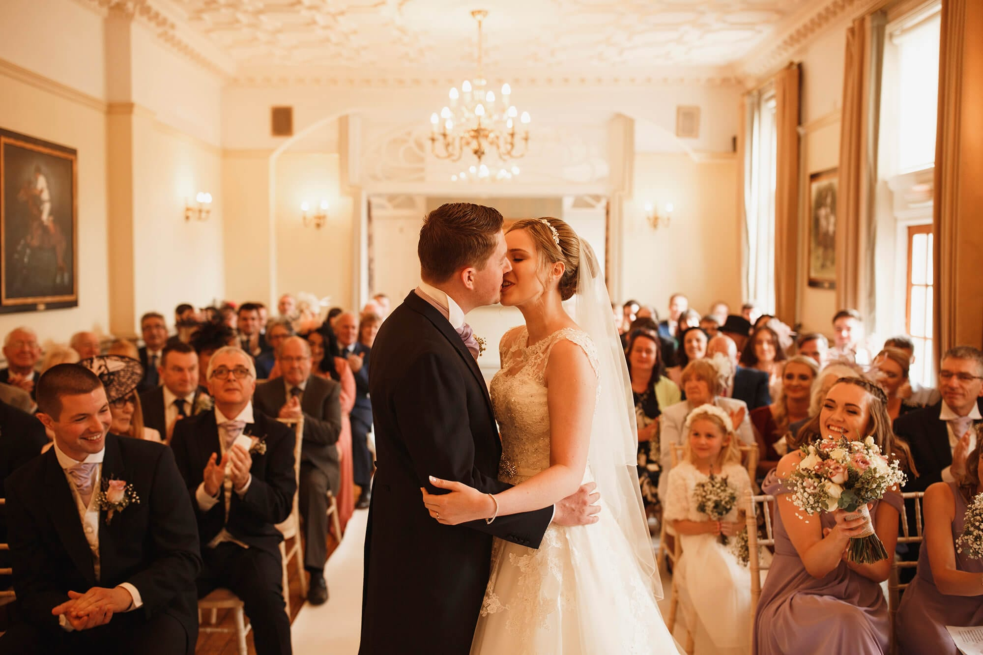 bride and groom kiss at nunsmere hall