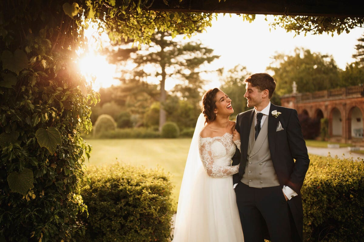 Bride and groom outside in sunlight Thornton Manor House