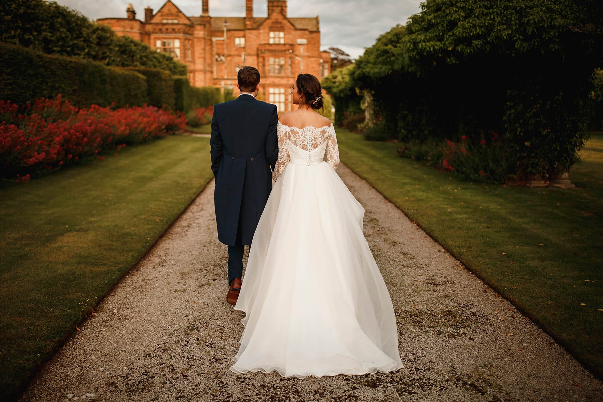 Bride and groom walking to Thornton Manor House